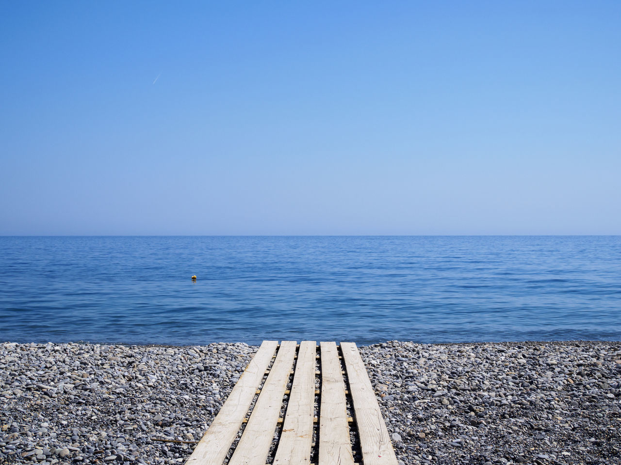 Sougia beach on the south side of Crete Beach Blue Clear Sky Holiday Horizon Over Water No People Outdoors Pebble Pebble Beach Sea Tranquil Scene Tranquility Vacations Walkway Water
