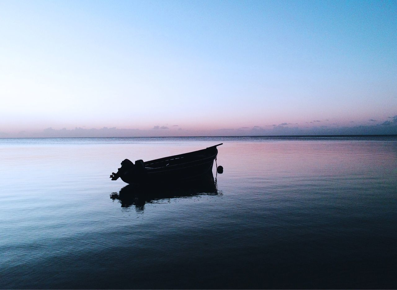 Boat On Sea Against Clear Sky During Sunset