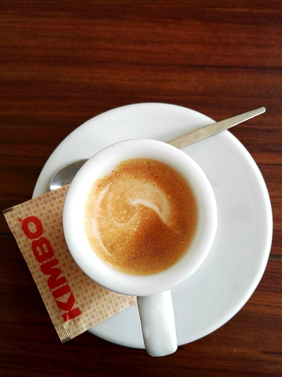 coffee cup, coffee - drink, food and drink, drink, table, refreshment, high angle view, saucer, frothy drink, indoors, freshness, directly above, no people, wood - material, close-up, froth art, food, cappuccino, day