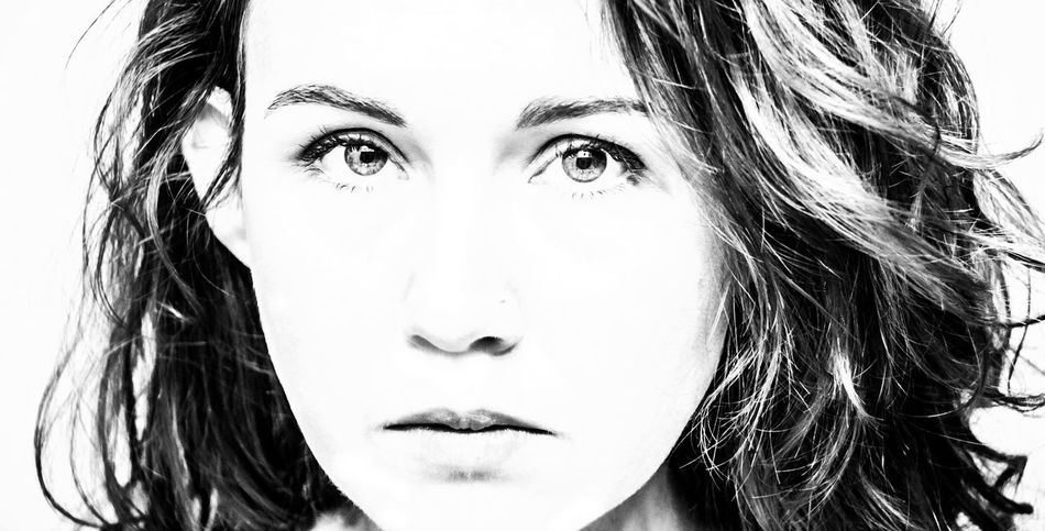 Beauty Black And White Close-up Confidence  Female Fierce Fierce Look Headshot Human Face Looking At Camera One Person One Woman Only Person Portrait Serious Stare Strong White Background Woman Young Adult Young Women