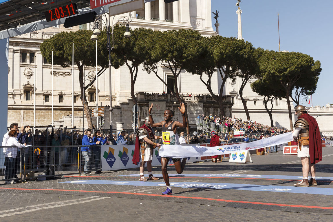 Rome, Italy - April 10, 2016: Amos Kipruto crosses the finish line in first place and won the men's race of Rome Marathon 2016. 2016 Amos Athlete Colors Competition Etiopian Finish Line  Kipruto Man Marathon Roma Runner Urban Winner Winners