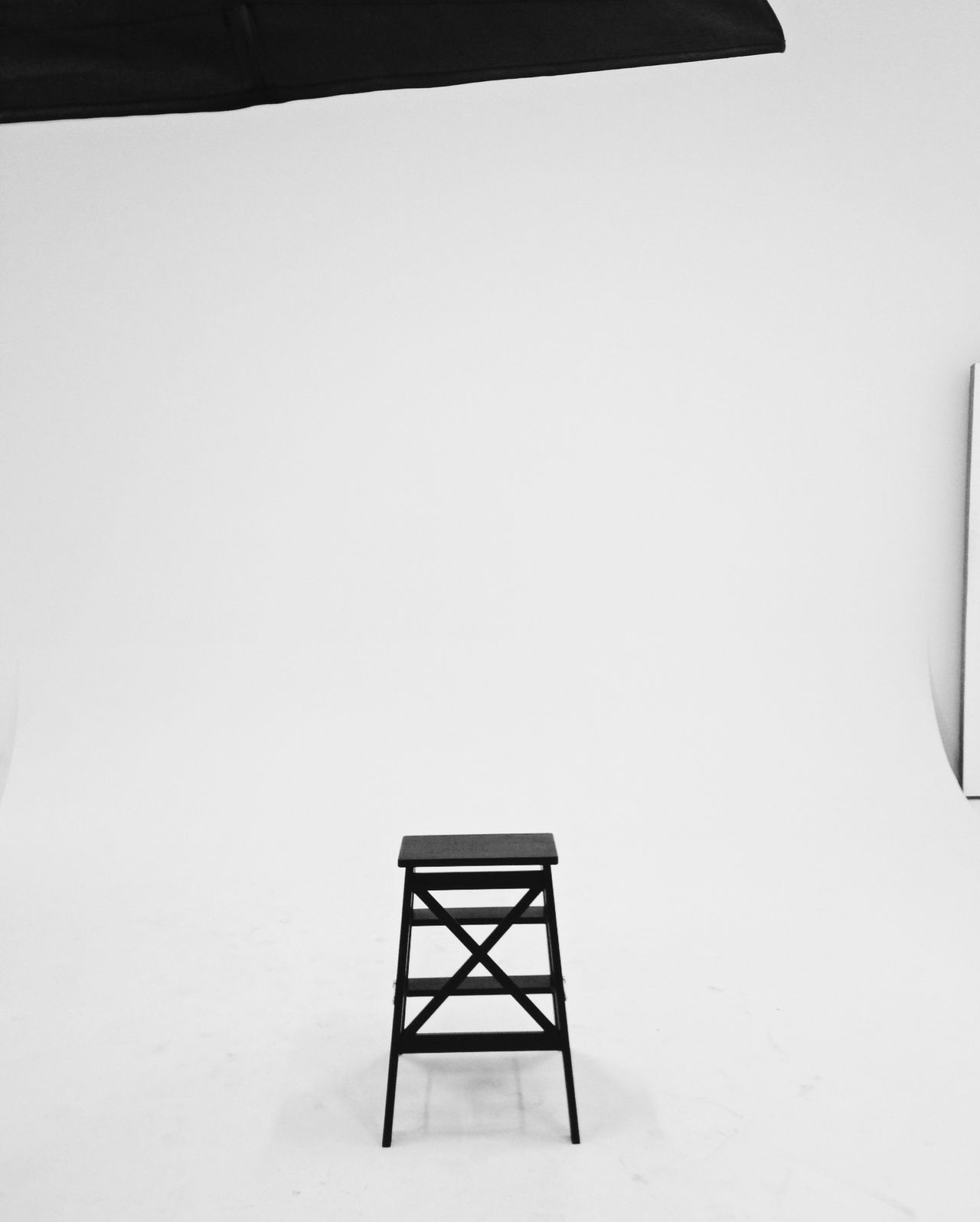 black chair in the studio No People Indoors  Blackandwhite White Background Monochrome Studio Shot Copy Space Photography Interior Design Chair
