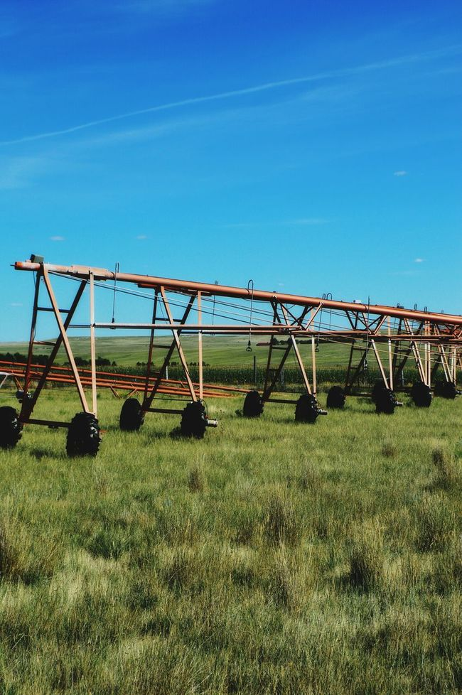 Extra pieced Prairie Center Wyoming Near County Road Out In The Boondocks Irragation Equipment August Afternoon Hot Summer Day