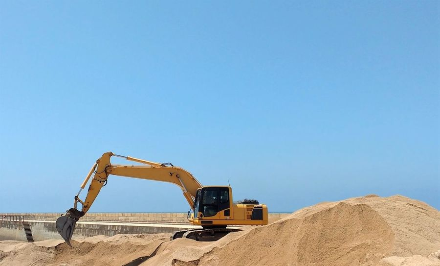 Blue Sky Building Work Construction Construction Machinery Construction Site Copy Space Digger Digging Earth Mover Excavator Heap Machinery Plant Sand Shovel Vehicle