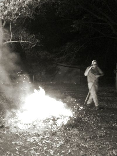 Black And White Friday my son trevor vol.fireman helping in a leaf in fire in the neighborhood. Adult Standing Reflection One Person Adults Only People Water Outdoors Men Night Full Length Only Men Nature Technology Tree Young Adult