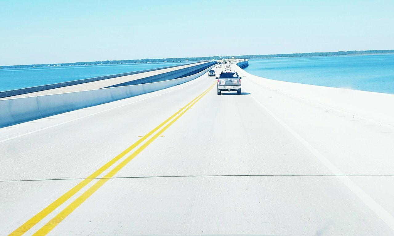transportation, road, the way forward, sea, outdoors, mode of transport, day, clear sky, no people, horizon over water, nature, scenics, sky
