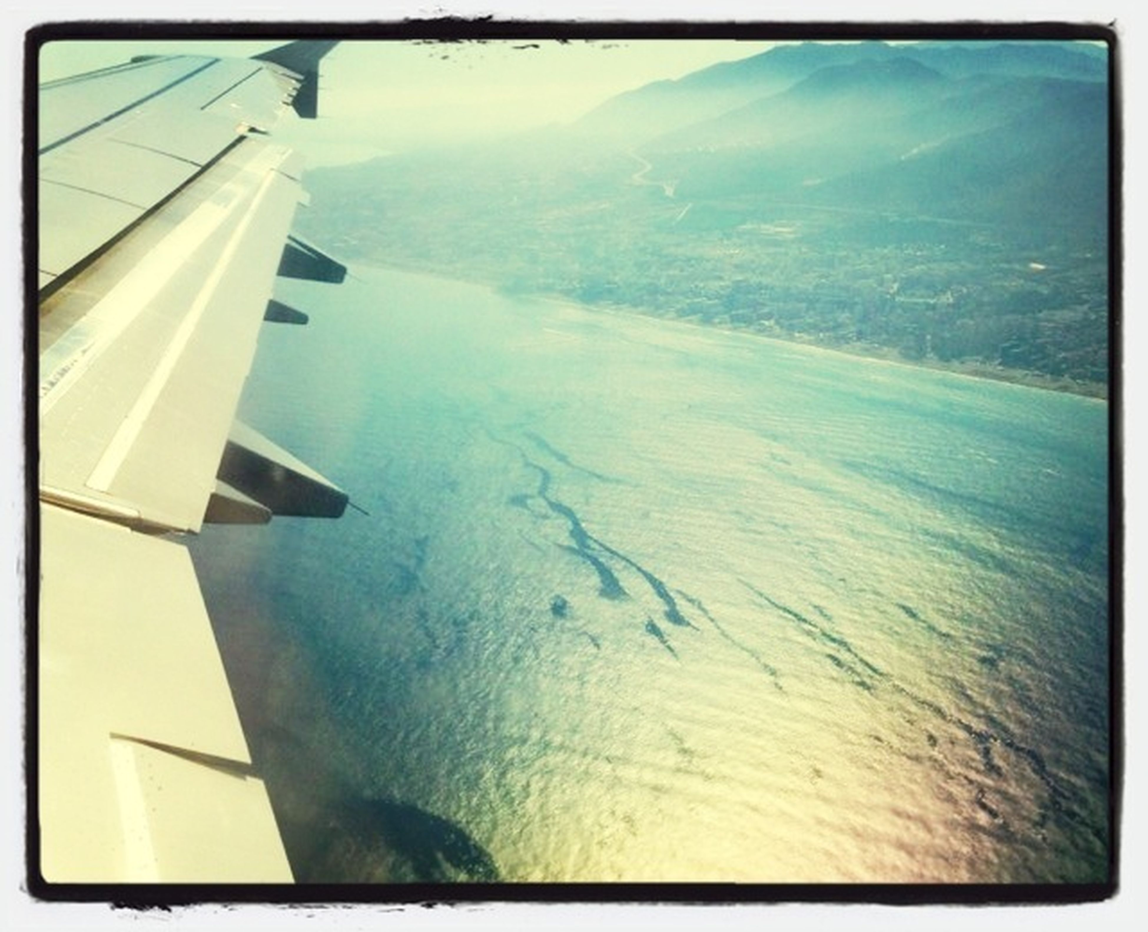 transportation, airplane, aerial view, mode of transport, aircraft wing, landscape, air vehicle, flying, cropped, scenics, part of, mountain, nature, beauty in nature, transfer print, tranquil scene, tranquility, travel, journey, on the move