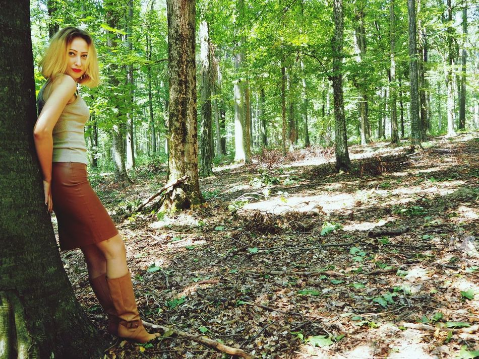 Tree Portrait Beauty Leisure Activity Female Portrait Fashion&love&beauty Fashion Female Model Lifestyle The Week On EyeEm EyeEmNewHere Fashion Model Blond Hair Woman Portrait Forest Trees Tree Trunk Forest Middle Aged Woman Beautiful Woman Red Lipstick Red Lips Women Leather Skirt  Leather Boots Fairy Lost In The Landscape