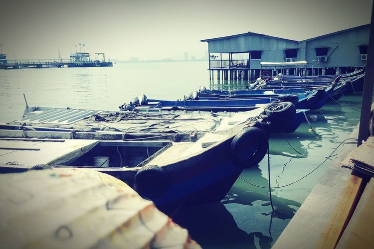Water Nautical Vessel Sea Pier Moored Outdoors Day No People Harbor Sky Architecture Gondola - Traditional Boat Water Village Old Boats Water Transportation Fishing Boat Wooden House Jetty Wooden Bridge