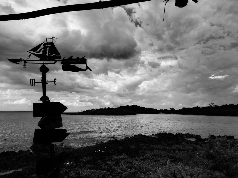 Monochrome Photography Cloud - Sky Riverbank Tranquil Scene Cloudy Scenics Tranquility Outdoors Non-urban Scene Nature Day Remote Atmospheric Mood In Front Of Storm Cloud End Of Land Weathercock Ship And Wale Travel Destinations Caribbean