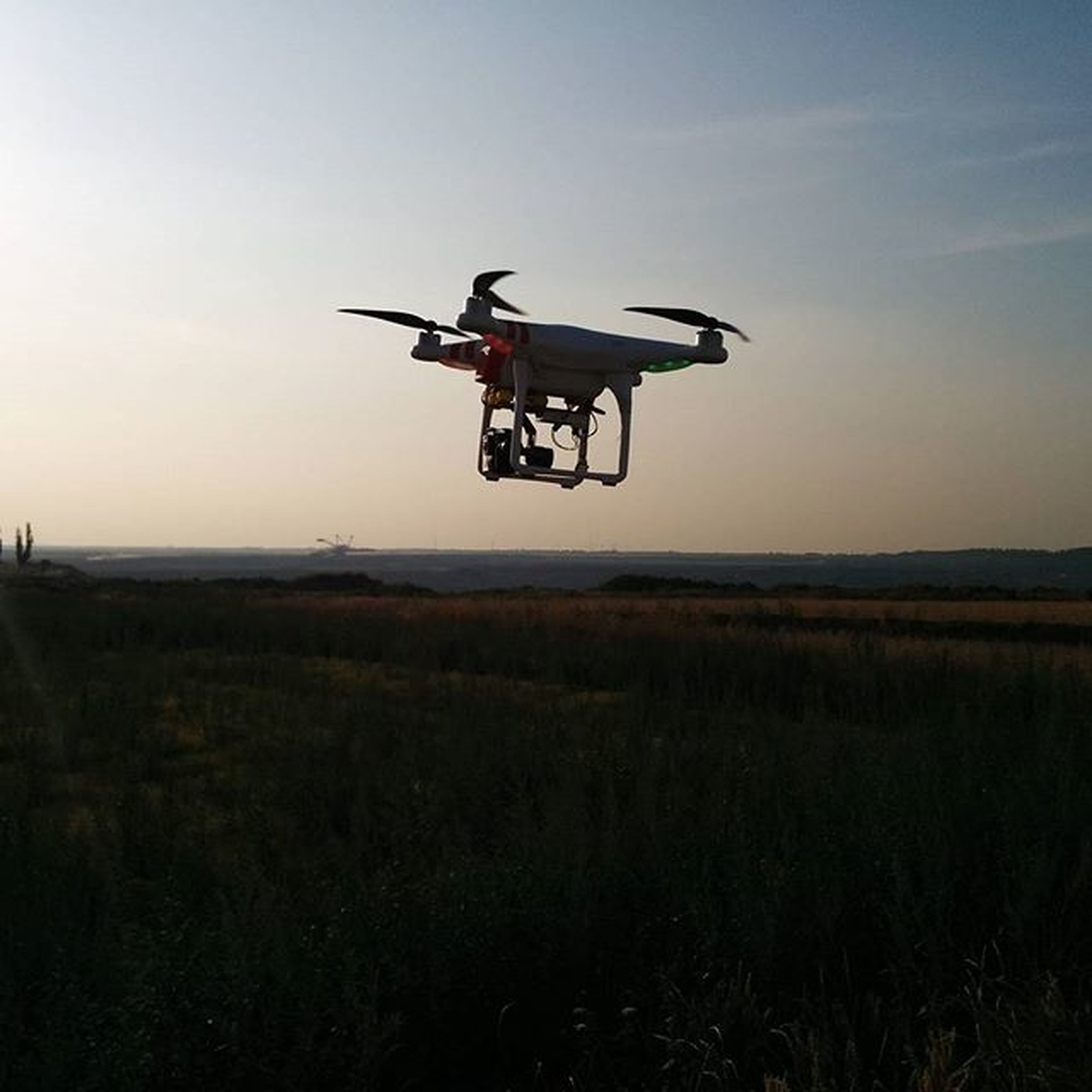 transportation, flying, mode of transport, mid-air, air vehicle, airplane, landscape, field, sky, clear sky, copy space, land vehicle, on the move, travel, nature, scenics, sunset, outdoors, grass, helicopter