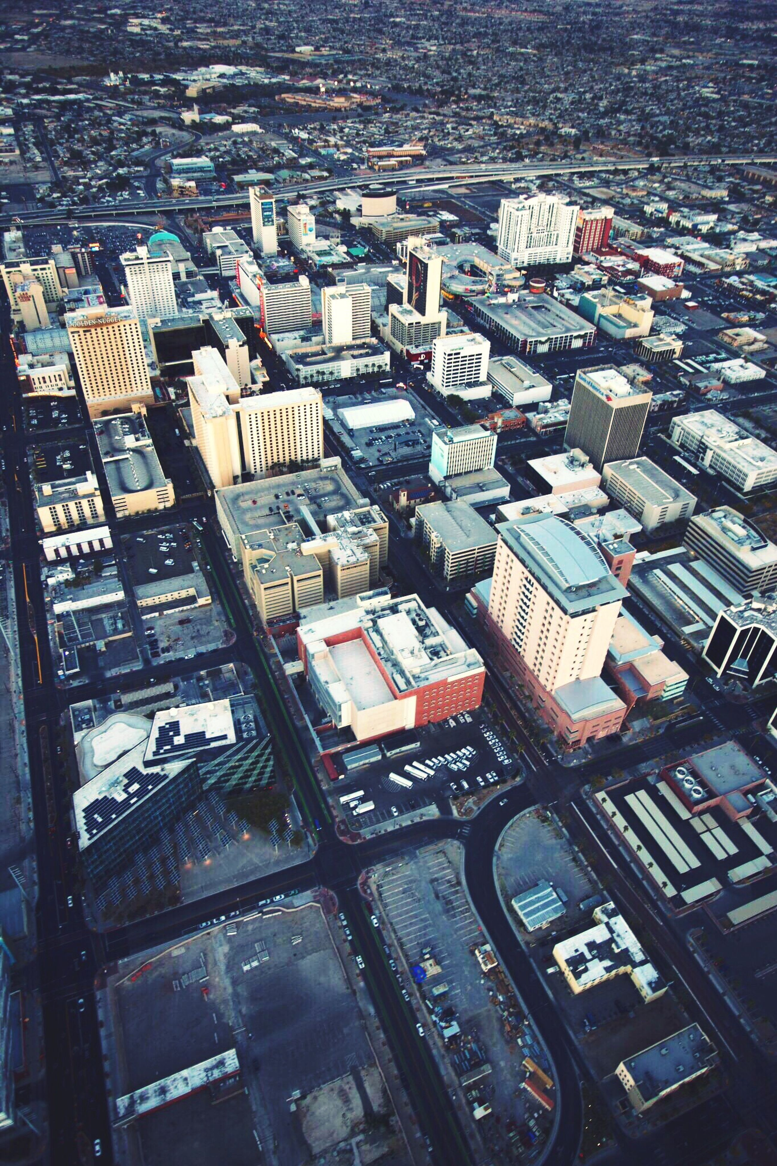 high angle view, building exterior, architecture, city, cityscape, built structure, crowded, aerial view, residential district, residential structure, residential building, elevated view, water, city life, skyscraper, outdoors, no people, day, tower, transportation