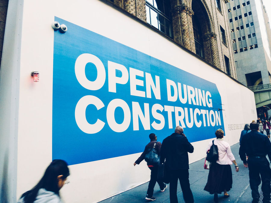 Open during construction meets two-eyed Big Brother Architecture Big Brother Building Cameras City City Life Come In Construction Information NYC NYC Photography Open During Construction Pavement Pedestrians Street Streetphotography Text Under Construction... We're Open TakeoverContrast