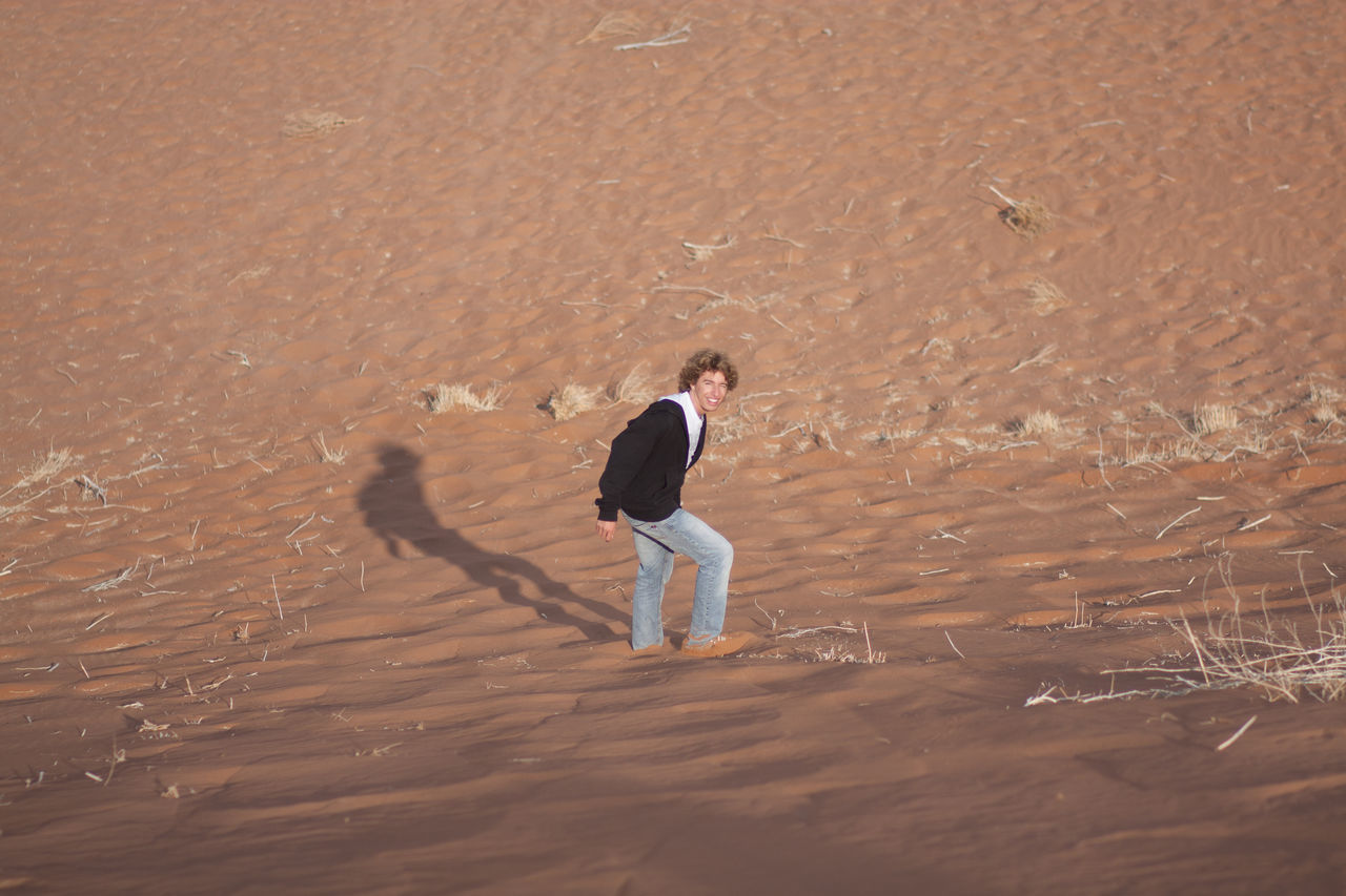 Beautiful stock photos of sand, Arid Climate, Casual Clothing, Caucasian Ethnicity, Day
