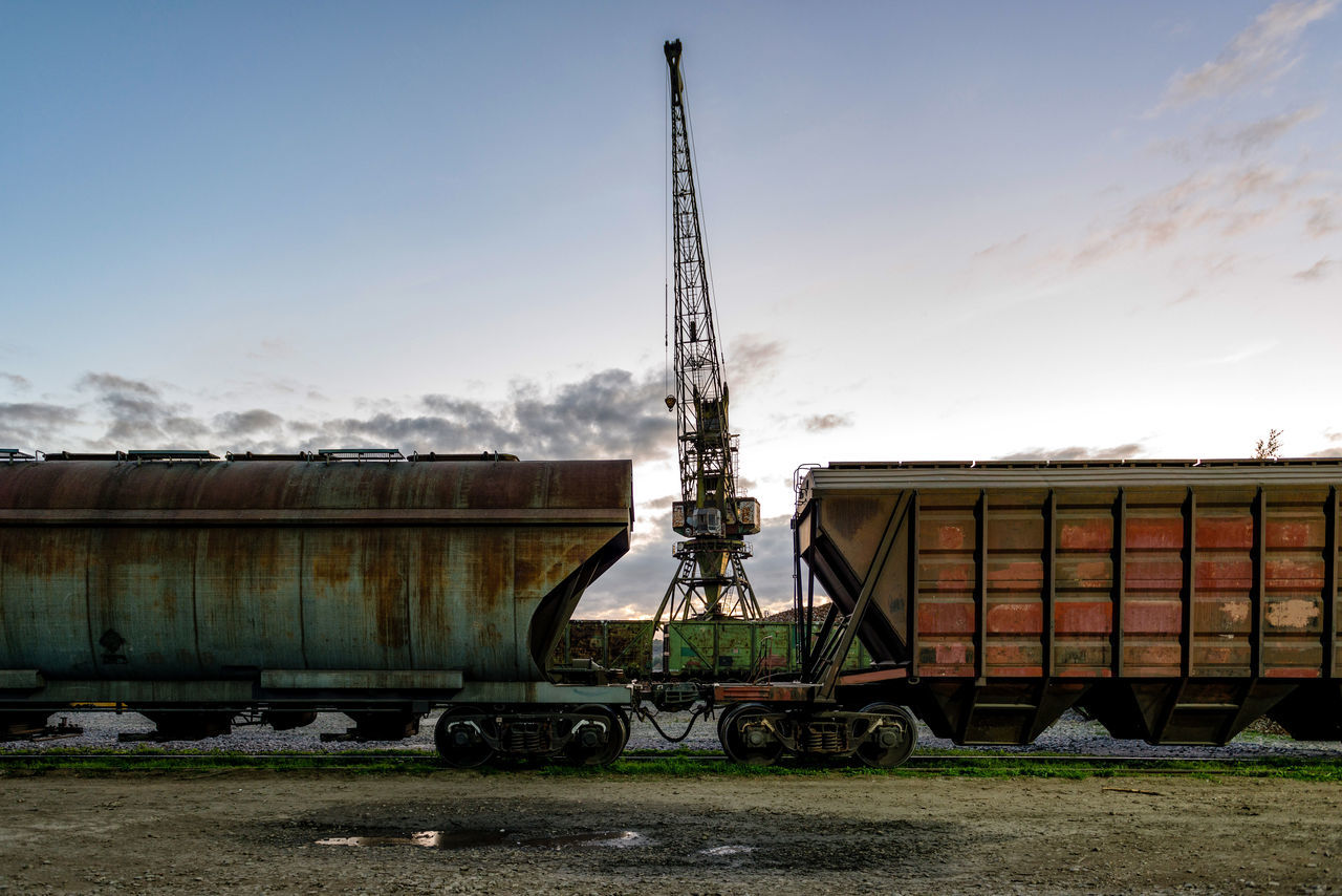 Railway cars waiting at the port of loading. Cargo Comercial Container Goods Harbor Industrial Locomotive Logistic Metal Railway Rain Shipping  Station Steel Terminal Transportation