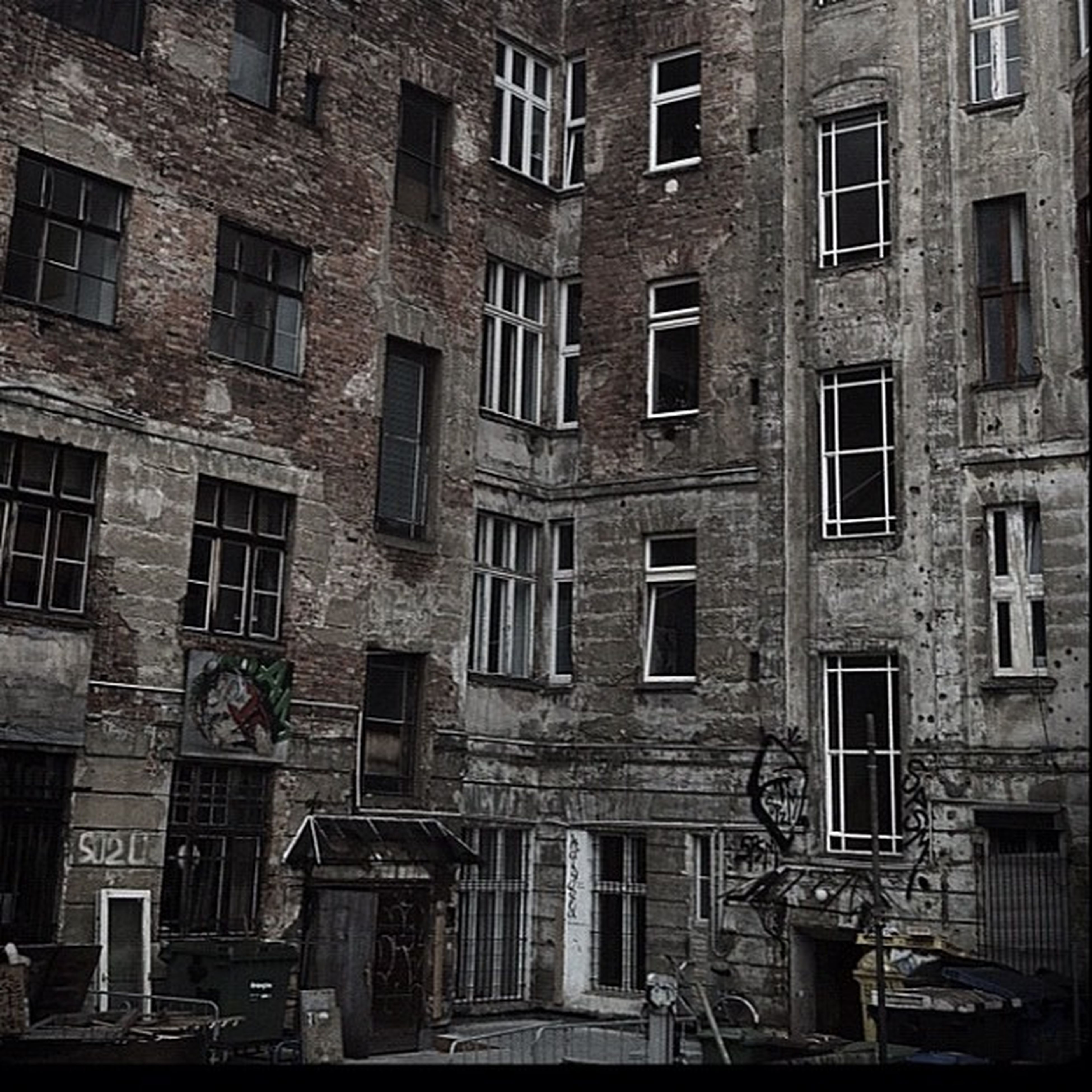architecture, building exterior, built structure, window, building, residential building, residential structure, city, old, day, outdoors, no people, in a row, full frame, abandoned, balcony, damaged, apartment, transportation, weathered