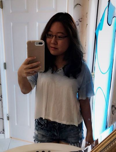 Mirror selfie One Person Wireless Technology Young Adult Real People Smart Phone Standing Portable Information Device Communication Selfie Front View Holding Young Women Lifestyles Photographing Technology Mobile Phone Eyeglasses  Photography Themes Indoors  Photo Messaging Mirrorselfie