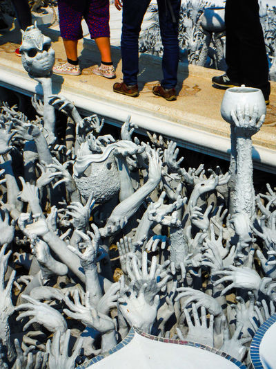 Crossing the Rivers of Hades Wat Rong Khun Chiang Rai Thailand Bridge - Man Made Structure Bridge Over Troubled Water Rivers Of Hades Bridge Through Hell Grasping Reaching Reaching Out Grabbing Undead Undead Army Lost Souls  Lost Soul Watrongkhun Chiang Rai, Thailand Darkart Spooky Watch Your Step Scupltures Clay Sculpture Clay Art Hands Hands And Arms
