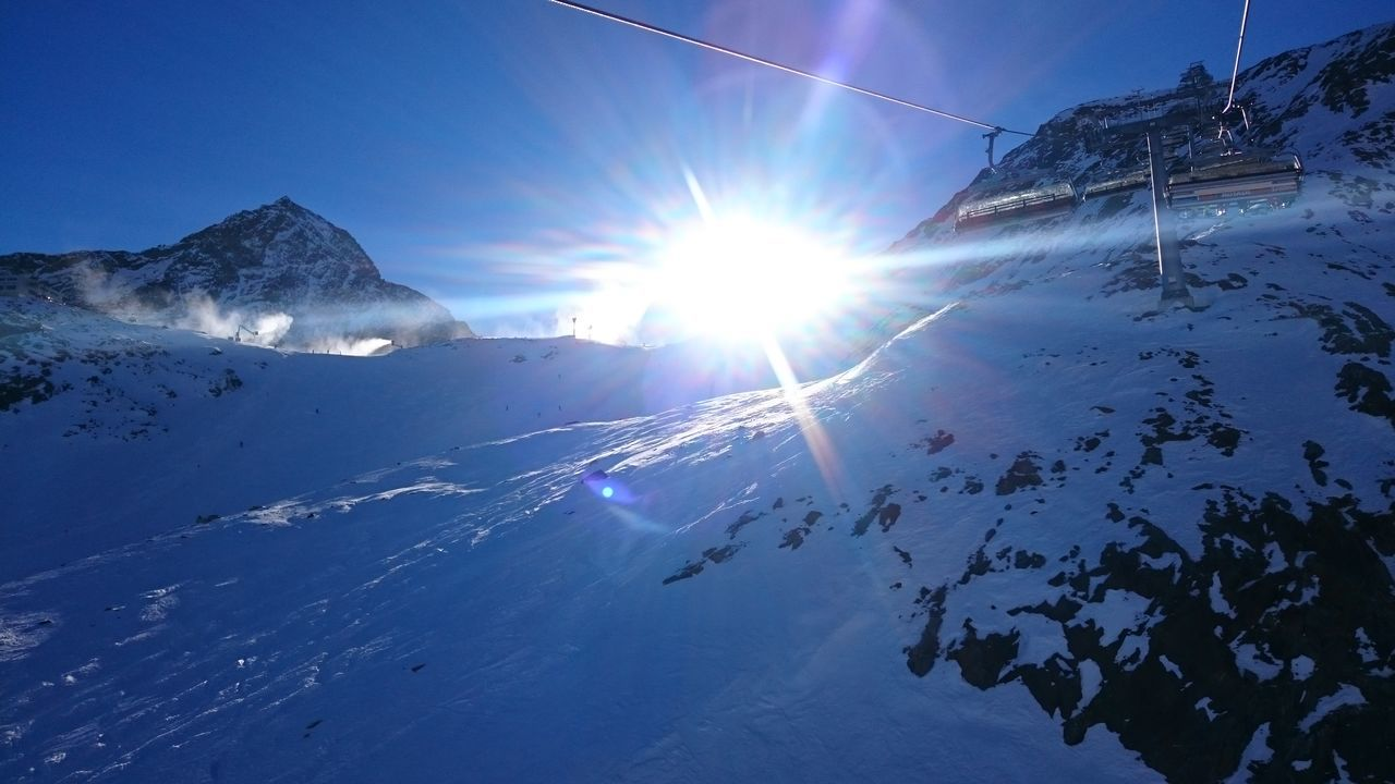 snow, winter, cold temperature, nature, beauty in nature, sunbeam, sun, sunlight, lens flare, weather, tranquility, scenics, outdoors, mountain, frozen, tranquil scene, snowcapped mountain, sky, no people, day, landscape, ski lift, iceberg