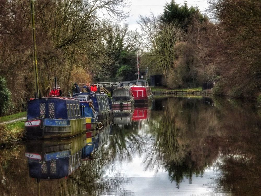 This was taken yesterday along the Leeds Liverpool canal a beautiful place for a walk Reflection Transportation Mode Of Transport Nautical Vessel Outdoors Bridge - Man Made Structure Leeds To Liverpool Canal Leeds Liverpool Canal UK Canals Canal Life History Canals And Waterways Fujifilm EyeEm Masterclass Creative Light And Shadow Malephotographerofthemonth Portrait Photography Architecture Creative Light And Shadow Color Photography Canal Boats Canals Of England Ormskirk Waterfront Water Reflections Reflections In The Water