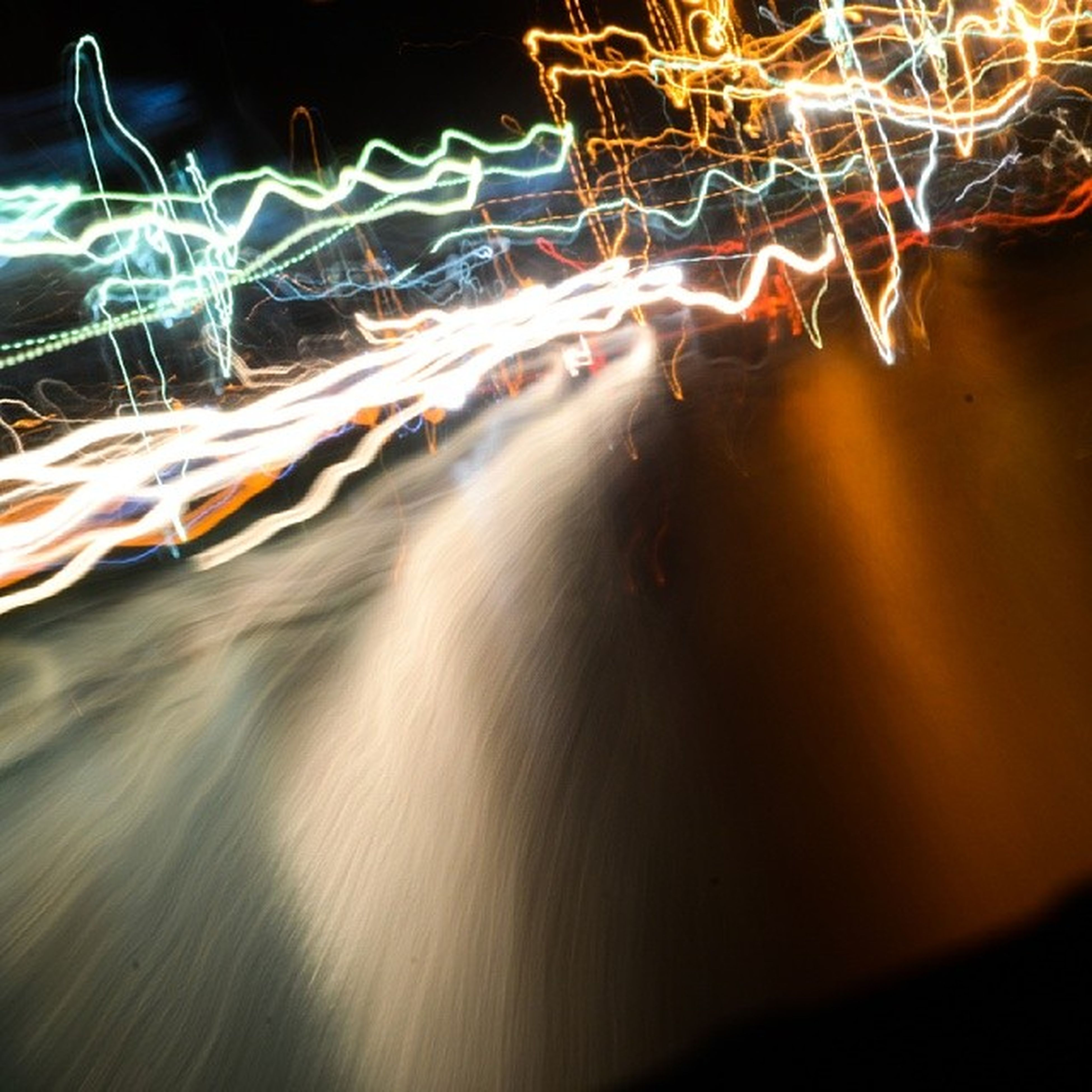 motion, long exposure, night, water, illuminated, blurred motion, speed, waterfront, light trail, splashing, glowing, rippled, animal themes, reflection, light painting, swimming, outdoors, abstract, no people, one animal