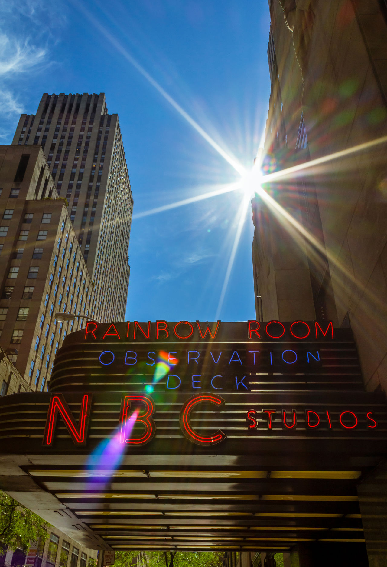 NBC studios entrance at Rockefeller Center - The Rainbow Room America Architecture Building Exterior Built Structure City Film Studio Lens Flare Low Angle View Nbc NBC Studios Neon Neon Lights New York New York City No People Outdoors Rainbow Room Rockefeller Center Signs Sky USA