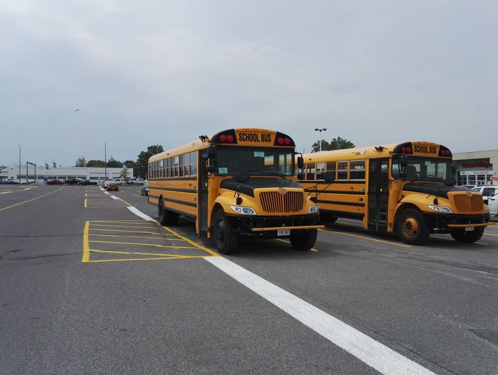 American Bus School Buses American Style Bus Day Land Vehicle Mode Of Transport No People Outdoors Parked Bus Road School Bus Sky Transportation Yellow Yellow Bus