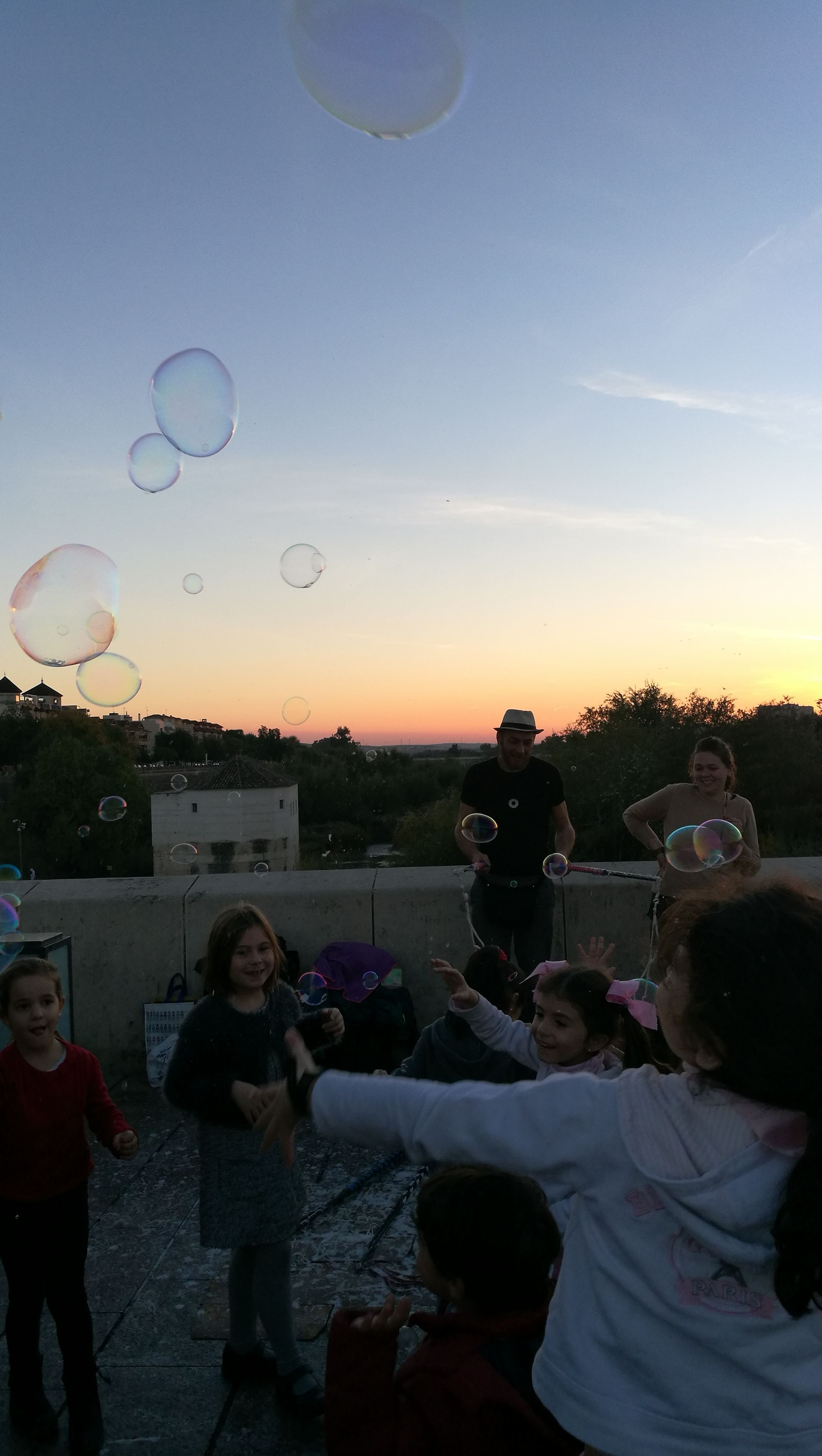 sky, togetherness, large group of people, sunset, adults only, celebration, people, outdoors, adult, women, day