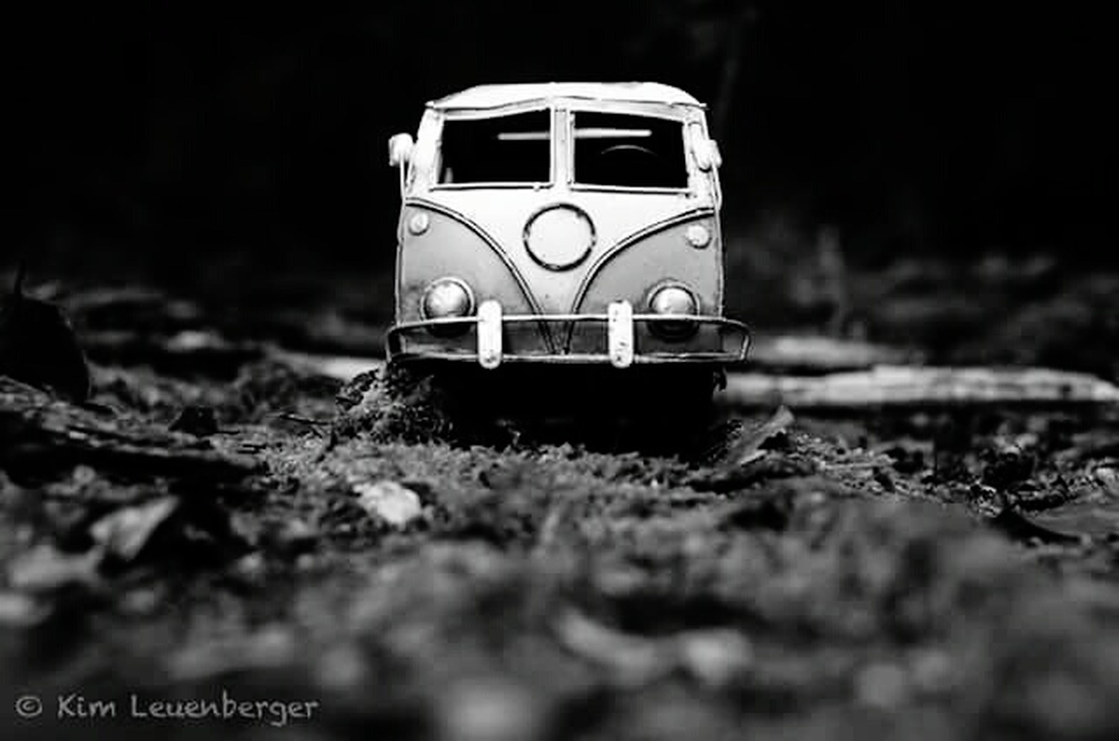 selective focus, focus on foreground, close-up, outdoors, abandoned, no people, field, transportation, obsolete, surface level, day, nature, building exterior, old, damaged, protection, metal, safety, built structure, grass