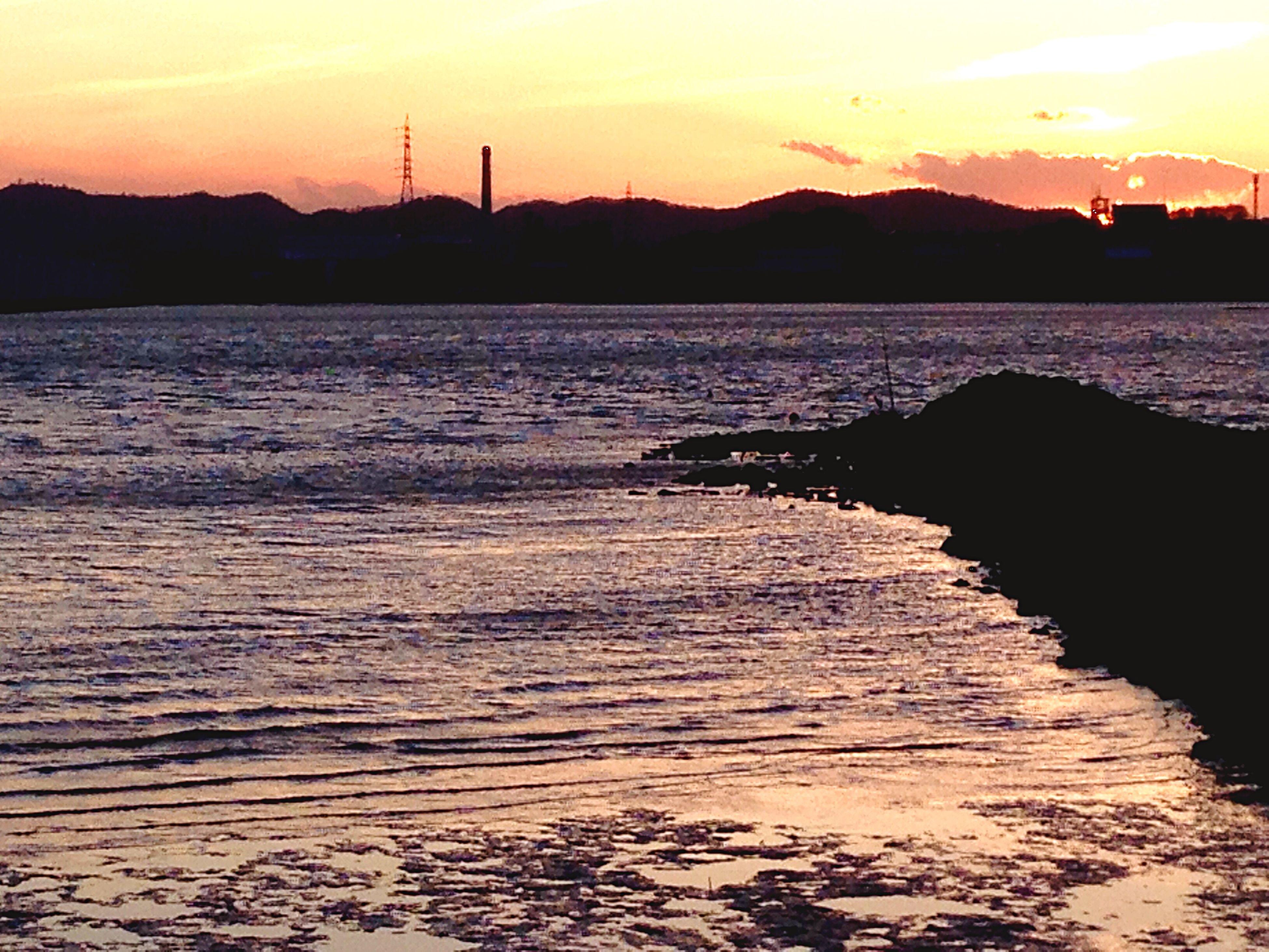 sunset, water, silhouette, tranquil scene, scenics, tranquility, mountain, sky, beauty in nature, sea, nature, reflection, orange color, sun, idyllic, rippled, lake, pier, dusk, mountain range