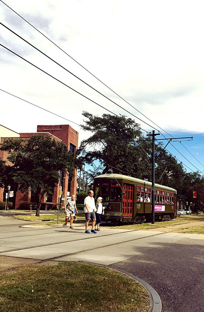 Architecture Built Structure Building Exterior Street Road Transportation Tree Sky Walking Full Length City Cloud Day City Life Outdoors Cable Power Line  Cloud - Sky New Orleans EyeEm New Orleans, LA New Orleans St. Charles Avenue City Life STREET CAR