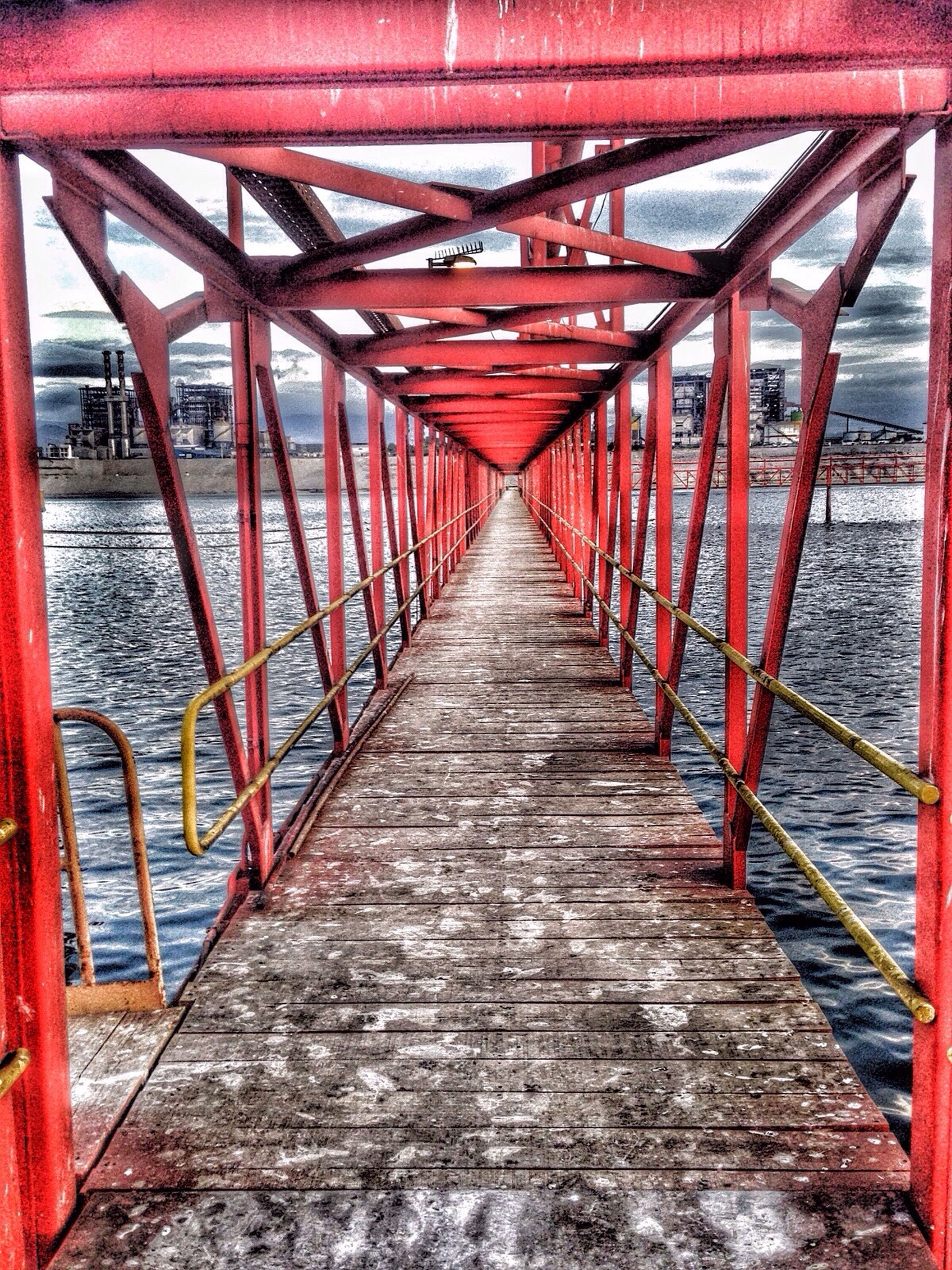 built structure, the way forward, architecture, connection, diminishing perspective, bridge - man made structure, railing, vanishing point, footbridge, red, bridge, long, transportation, wood - material, metal, walkway, day, no people, outdoors, narrow