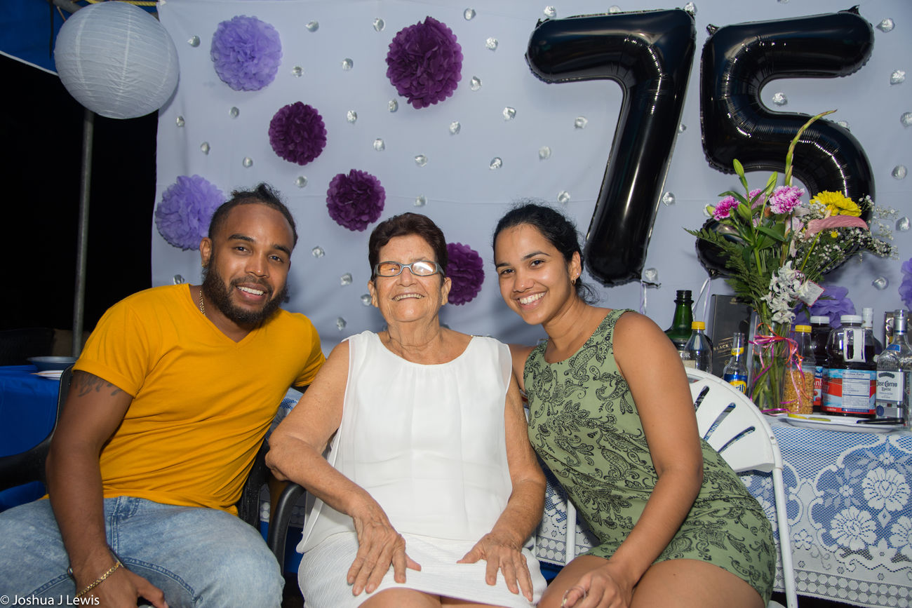 Togetherness Family Time Mid Adult Granny Smiling Casual Clothing Looking At Camera Birthdayparty Beautiful People Stillife Laughing Caribbean Trinidad And Tobago Beautiful Love Real People Party - Social Event Celebration FamilyTime Happiness Sitting Mature Adult