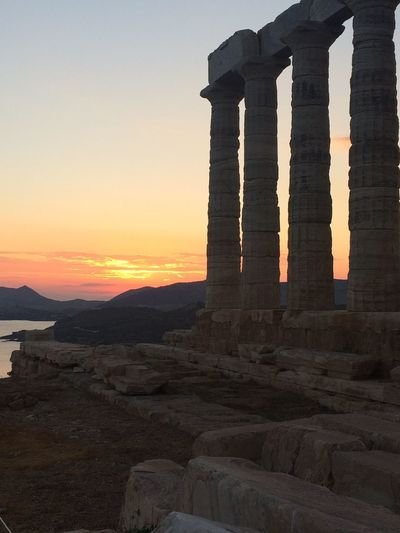 Temple at Sounio, Greece Ancient Ancient Architecture Ancient Civilization Ancient History Ancient Ruins Architecture Beach Beauty In Nature Built Structure City Day Greece History Nature No People Outdoors Sky Sounio Sunset Temple Travel Destinations Water