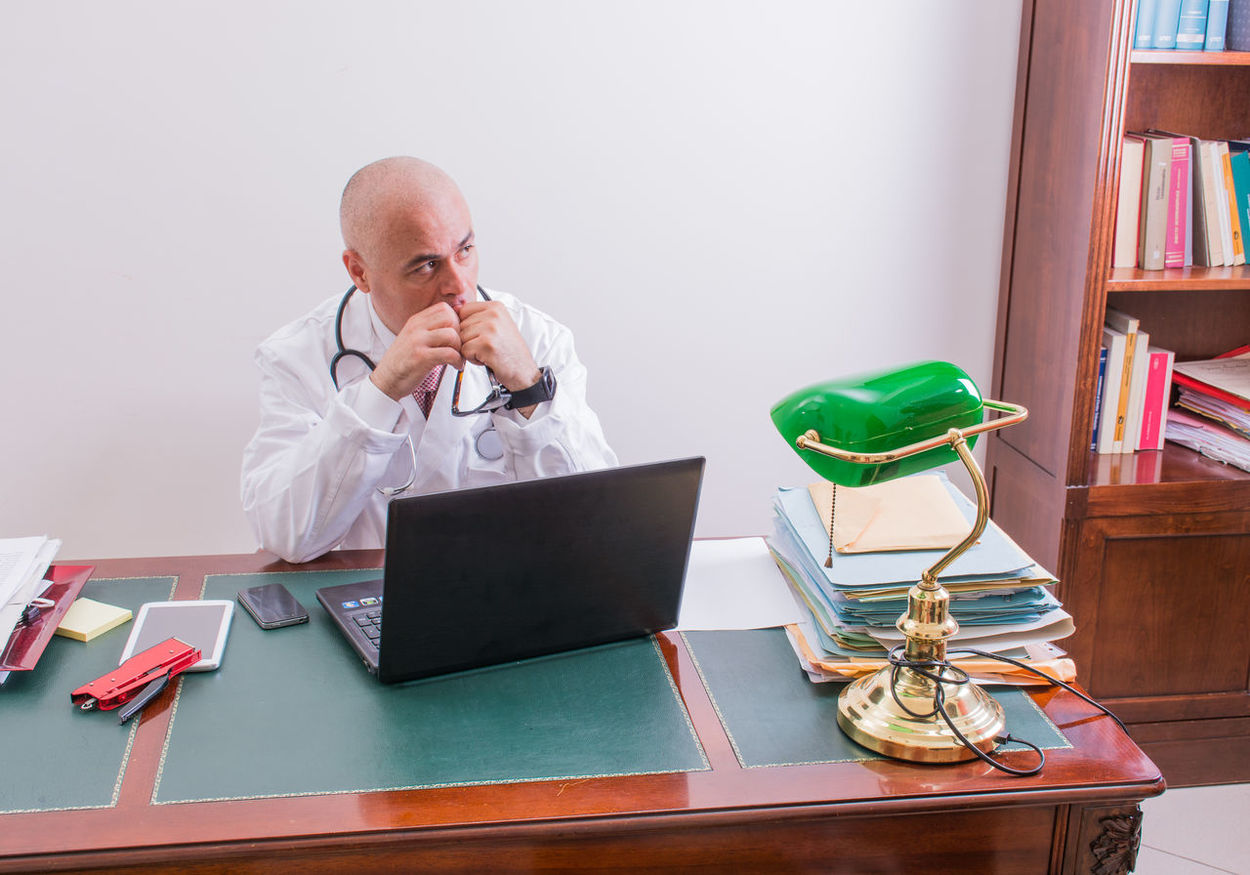 Bald Baldeneysee Baldhead Baldness Book Bookshelf Communication Desk Eyeglasses  Indoors  Laptop Mature Adult Mature Men Men Men At Work  Mensfashion Menstyle Menswear Mobile Phone Office One Person Table Technology Using Laptop Wireless Technology