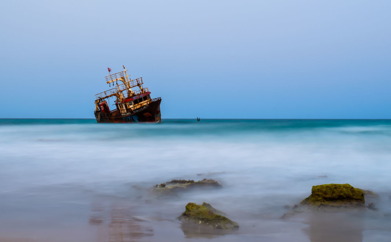 Sea Clearwaterbeach Seascape Photography Ships At Sea Tranquil Scene Eyeem Tunisia Enjoying Life Taking Photos Beachphotography Boats⛵️ Ships⚓️⛵️🚢 Sea View Sunkenboat Sunkship Nature Taking Pictures Seascape Sunk Boat