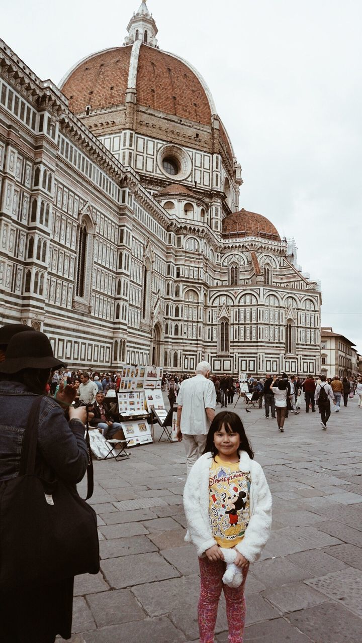 architecture, real people, travel destinations, built structure, dome, large group of people, history, building exterior, tourism, religion, spirituality, place of worship, women, travel, leisure activity, facade, day, lifestyles, outdoors, standing, sky, baroque style, adult, people