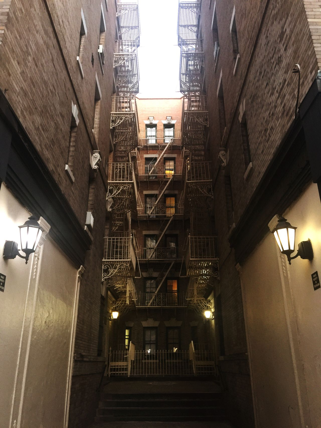 Adapted To The City Architecture Staircase Low Angle View Illuminated Fire Escape Lamps House Windows Simmetry Building Exterior Beautiful