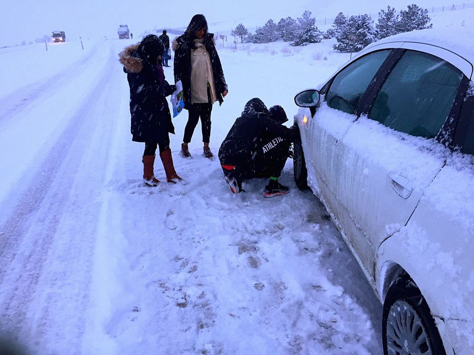 Stuck in snow, somewhere in between Konya and Cappadocia, trying to install chains for the first time Snow Winter Real People Traveling By Car Roadtrip Stuck In Snow Turkey Konya Cappadocia/Turkey Friends ❤ Traveling Home For The Holidays Trying To Get Home Traveling Home For The Holidays