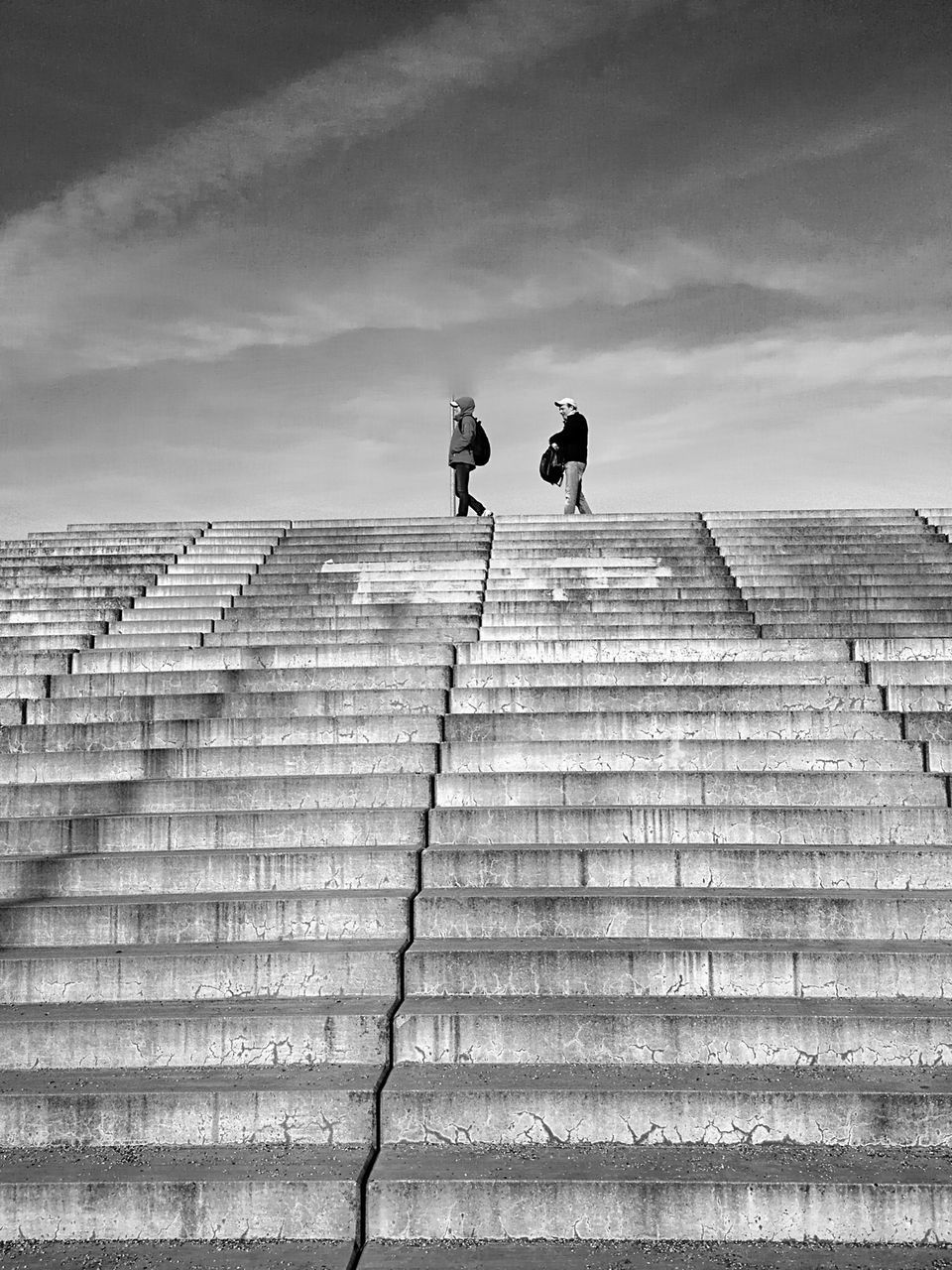 steps, steps and staircases, staircase, full length, two people, walking, rear view, stairs, built structure, men, low angle view, sky, cloud - sky, architecture, day, outdoors, real people, adult, people