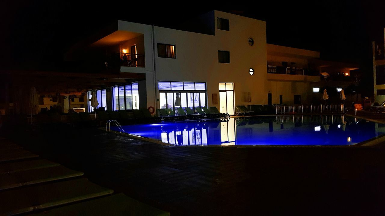 Hotel and Swimming pool Night Illuminated Architecture No People Outdoors Crete Island Palm Tree Water Heat Weather Reflection Scenery Silhouette Pool Swimming Pool Hotel Sunbed Gouves