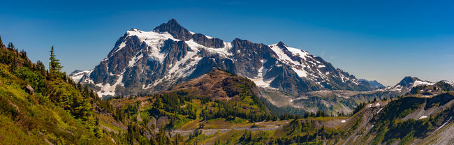Mt. Shuksan and Artist Point. The perfect time to visit Mt. Baker. The wildflowers were blooming and the weather is perfect. Beauty In Nature Blue Chain Lakes Trail Day Landscape Majestic Mountain Mountain Range Mt. Baker Mt. Shuksan Nature No People Non-urban Scene Out Outdoors Photography Remote Rock Formation Scenics Snow Snowcapped Mountain Sunset Travel Destinations Washington Washington State