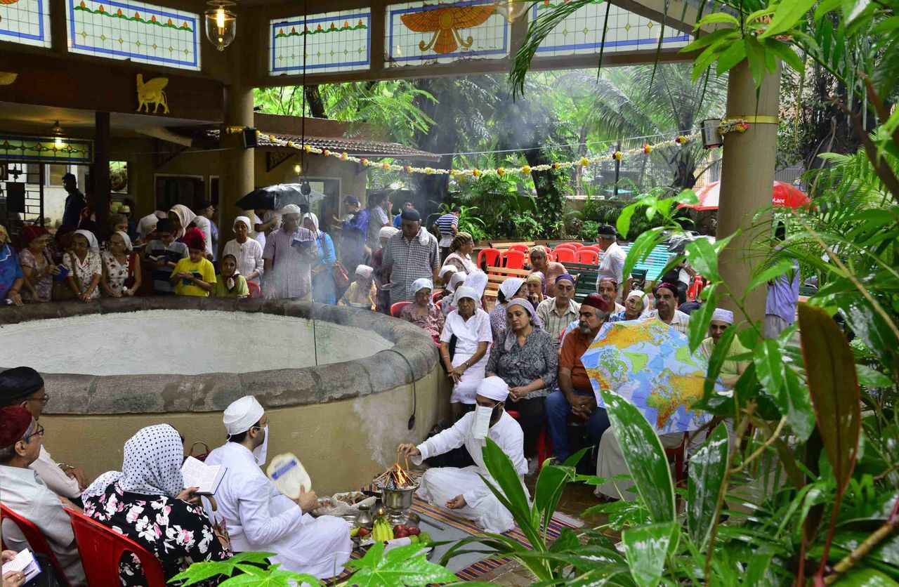 Good Deeds: Parsis pray at the Bhikha Behram well on Sunday 25th Sept 2016 for community's well-being. City Life Cultures Day Large Group Of People Men Outdoors Person Praying Standing Togetherness Parsi