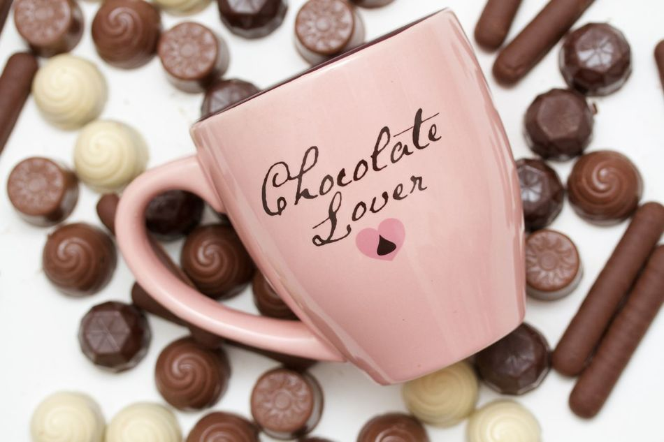 chocolate truffes in a pink mug on white background Chocolate Close-up Day Freshness Heart Shape Indoors  Large Group Of Objects Love No People Pink Mug Text Truffles