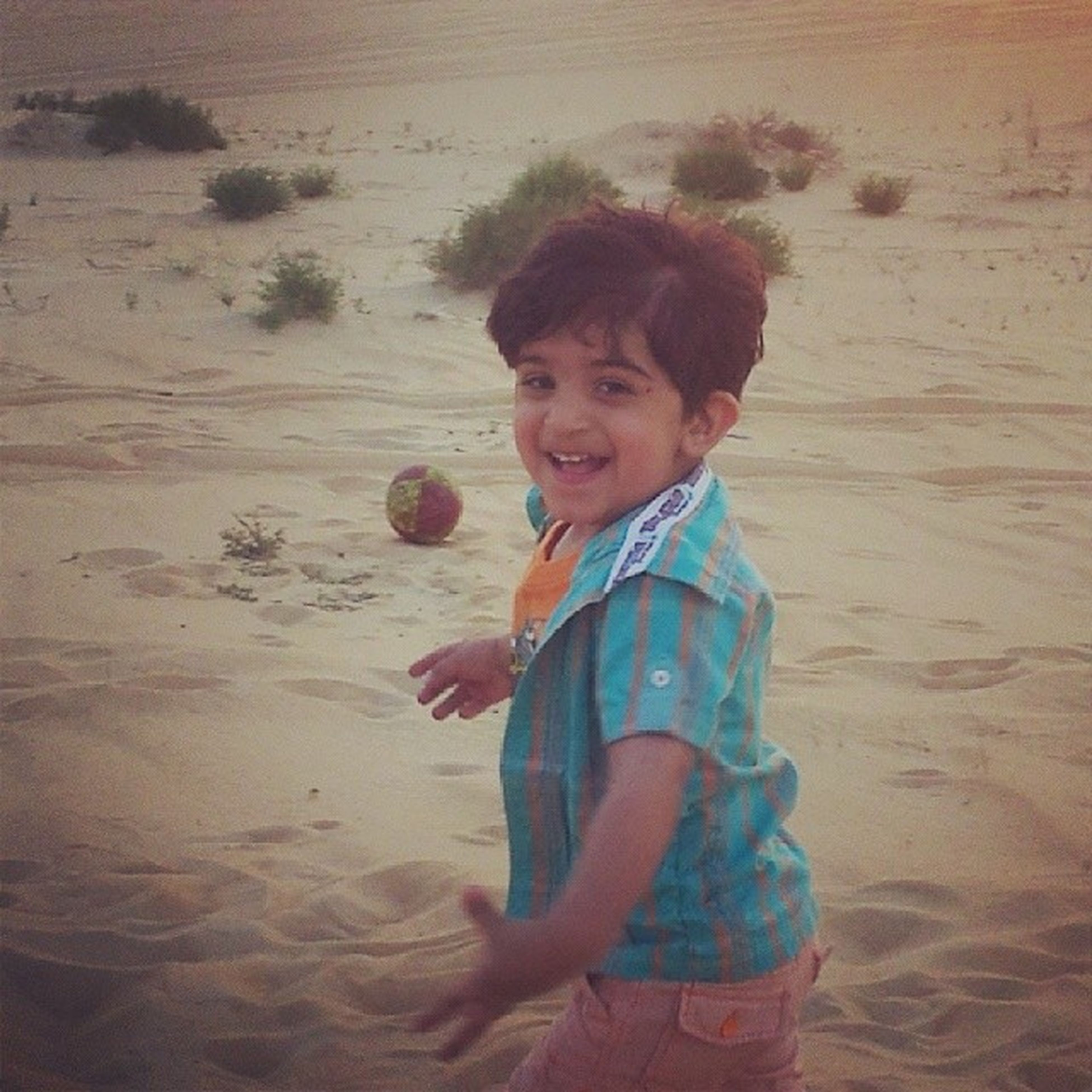 childhood, person, elementary age, lifestyles, sand, leisure activity, boys, beach, casual clothing, innocence, cute, full length, portrait, looking at camera, smiling, happiness, girls, front view