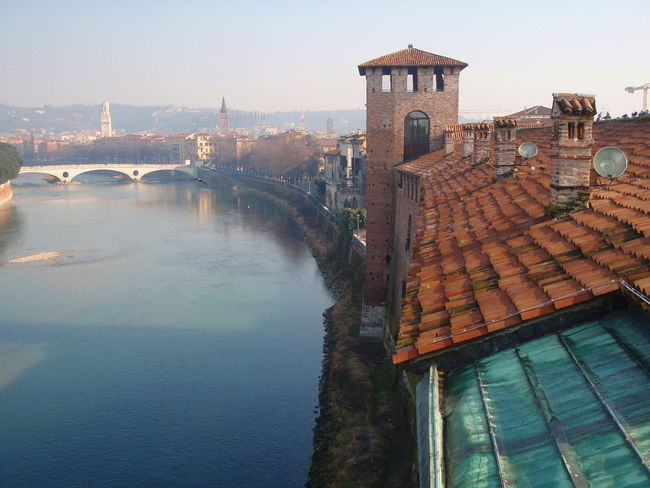 Adige Adige River Arch Architecture Bridge Bridge - Man Made Structure Building Exterior Built Structure Castelvecchio City City Life Clock Tower Connection Day Engineering High Angle View Residential Building Residential Structure River Riverside Roof Tower Travel Destinations Water Waterfront