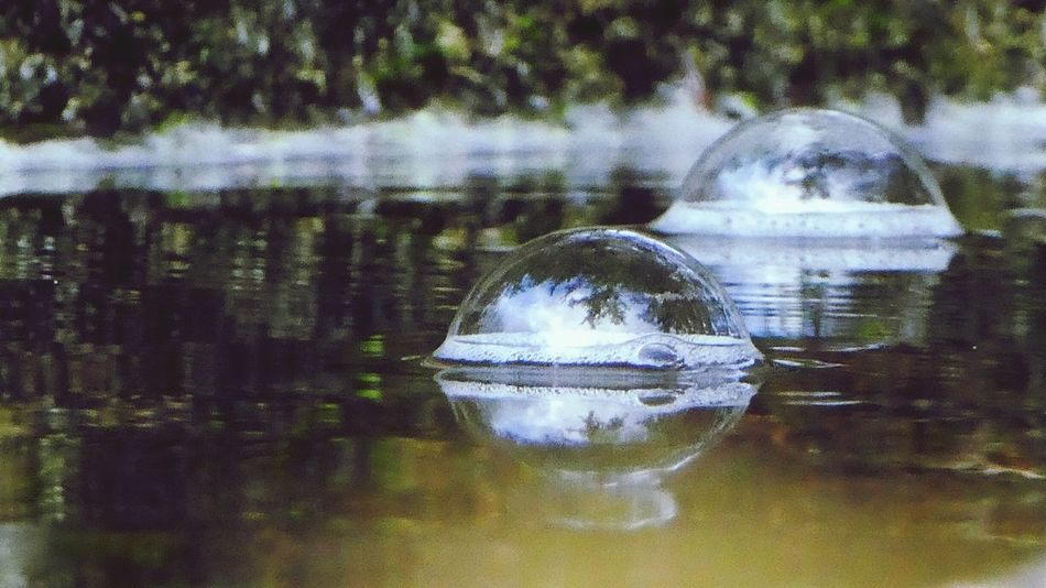 I always carry a spare bubble in case the one I live in now bursts.... Reflection Water Nature Outdoors Bubble Tiny Bubbles Big Bubbles Living In A Bubble Bubbles In WaterNo People Day Simple Beauty Simple Quiet Love Nature Low Angle View Sky And Clouds In A Bubble