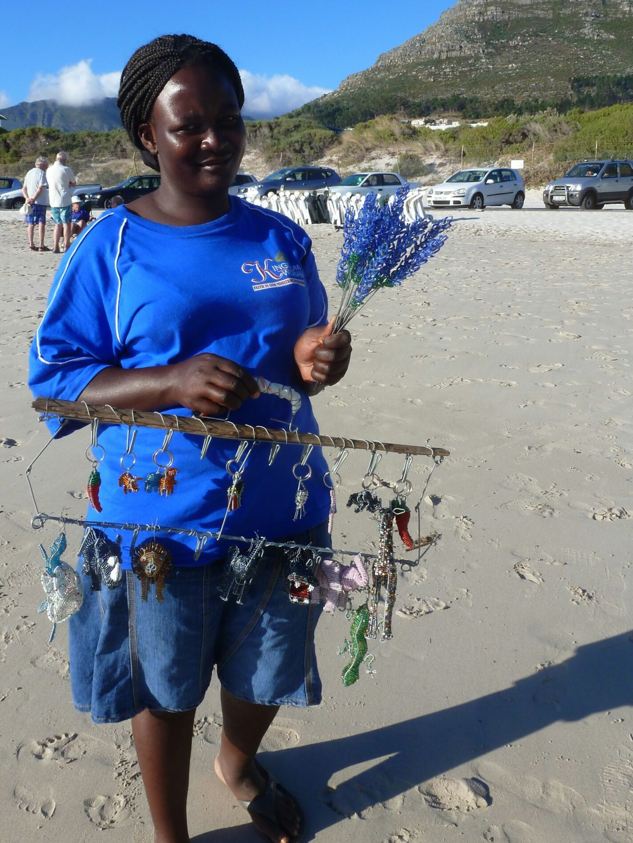 People Of The Oceans Check This Out Beach Life Beach Photography Ocean Beach Hout Bay Beach Hout Bay South African Woman Selling At The Beach Oceanside Blue Color Blue Clothes Blue Flowers Blue Natural Light Portrait Eye For Photography On The Way People And Places light and reflection waiting game Miles Away Women Around The World