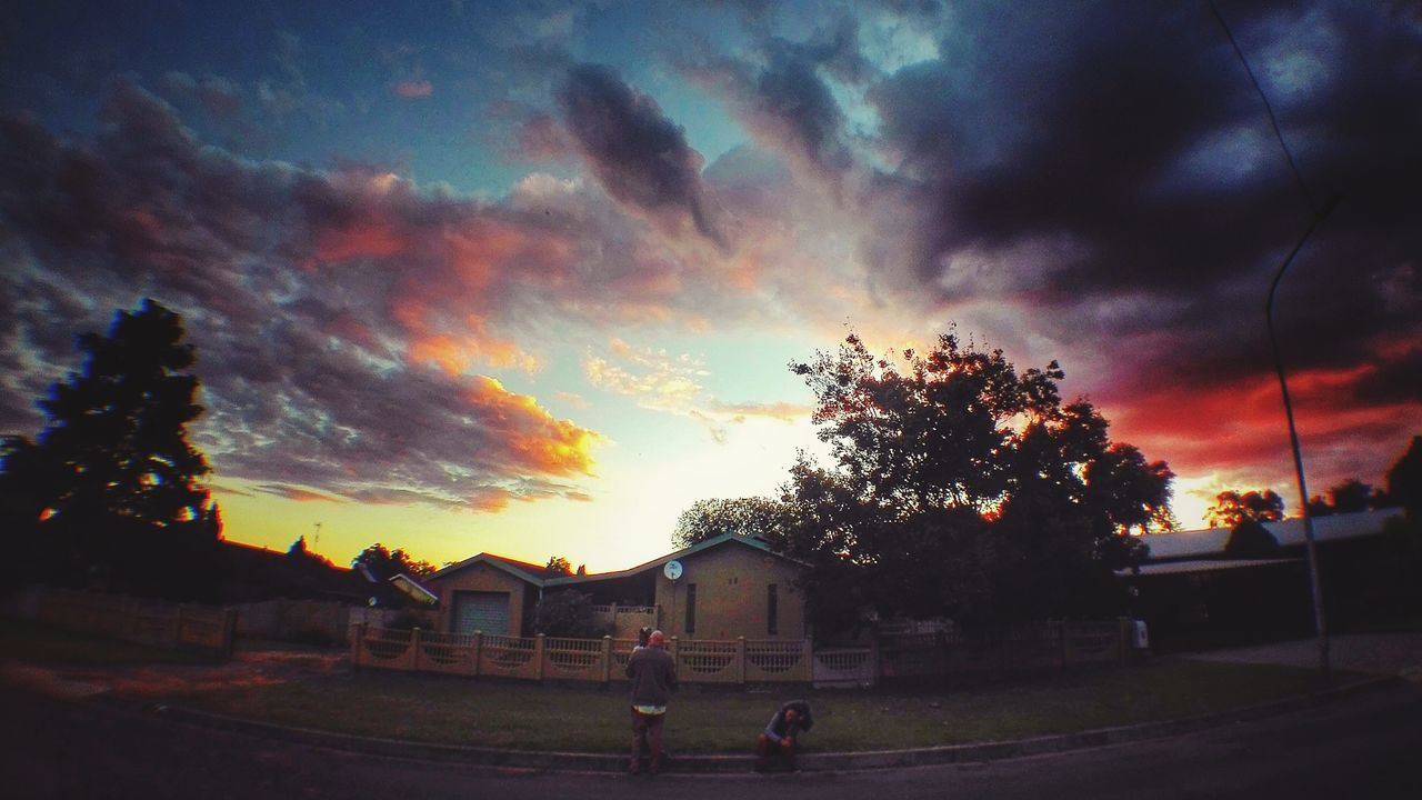 Sunset Cloud - Sky Rural Scene Outdoors Tree People Sky Nature Day Neighborhood Streetphotography Wide Shot Wide Angle Soccer Architecture