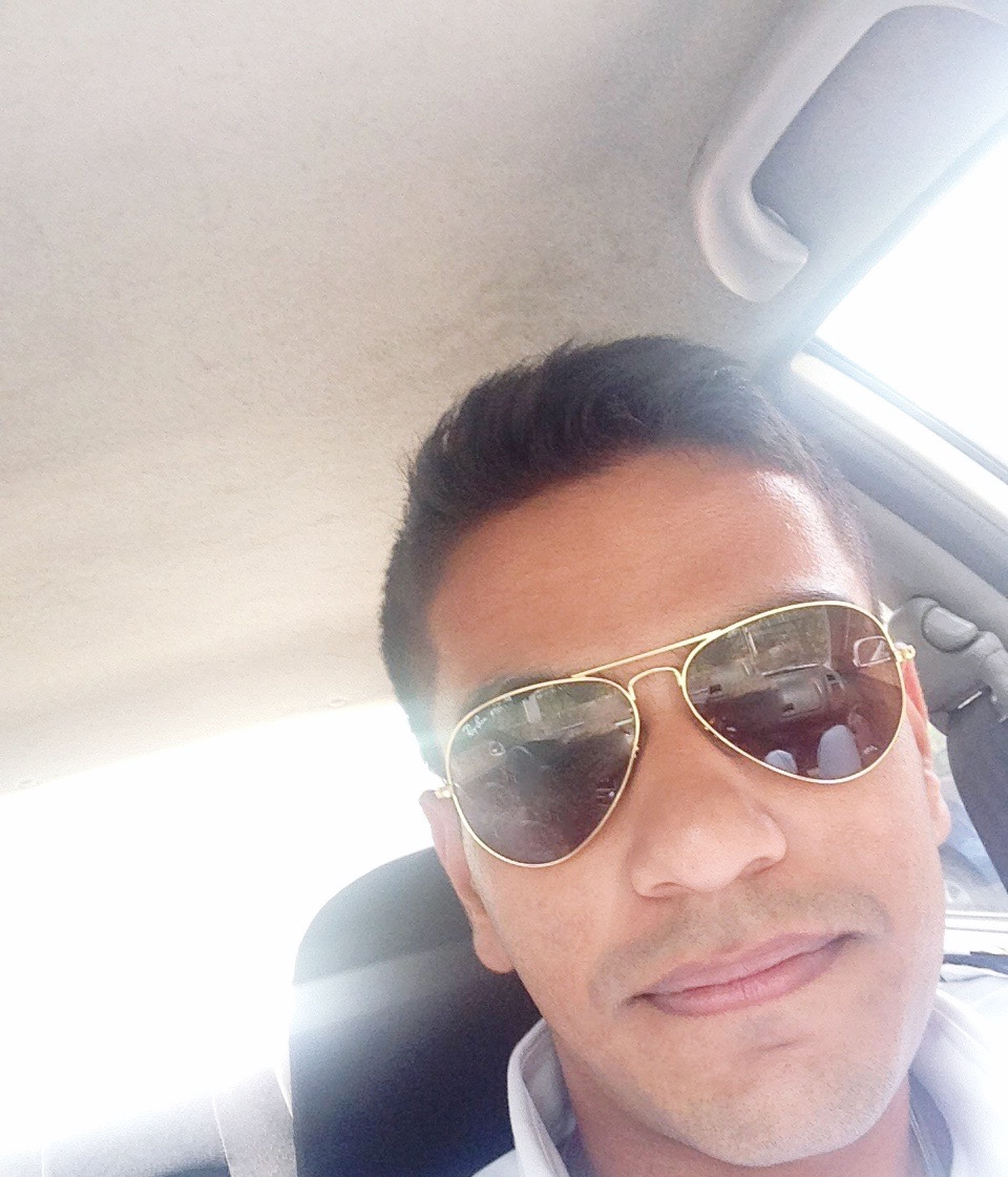 sunglasses, young adult, headshot, person, lifestyles, looking at camera, leisure activity, portrait, young men, front view, head and shoulders, transportation, close-up, mid adult, mode of transport, smiling, reflection